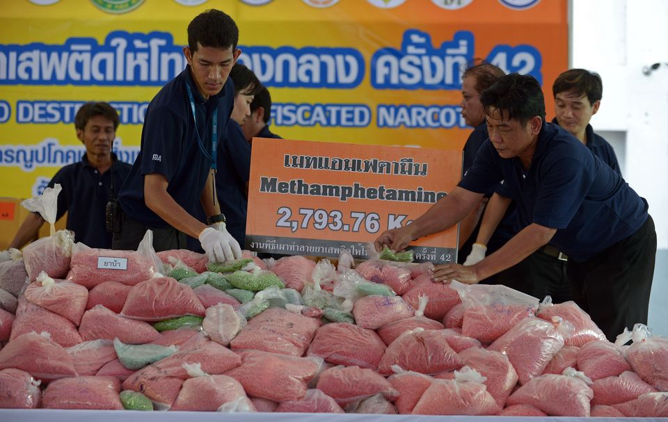 Thai officials check packs of confiscated narcotics before destroying them marking the UN's International Day Against Drug Ab