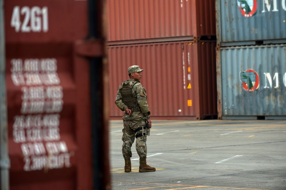 A Panamanian soldier stands guard near a container of the North Korean Chong Chon Gang vessel, where an alleged ageing Soviet
