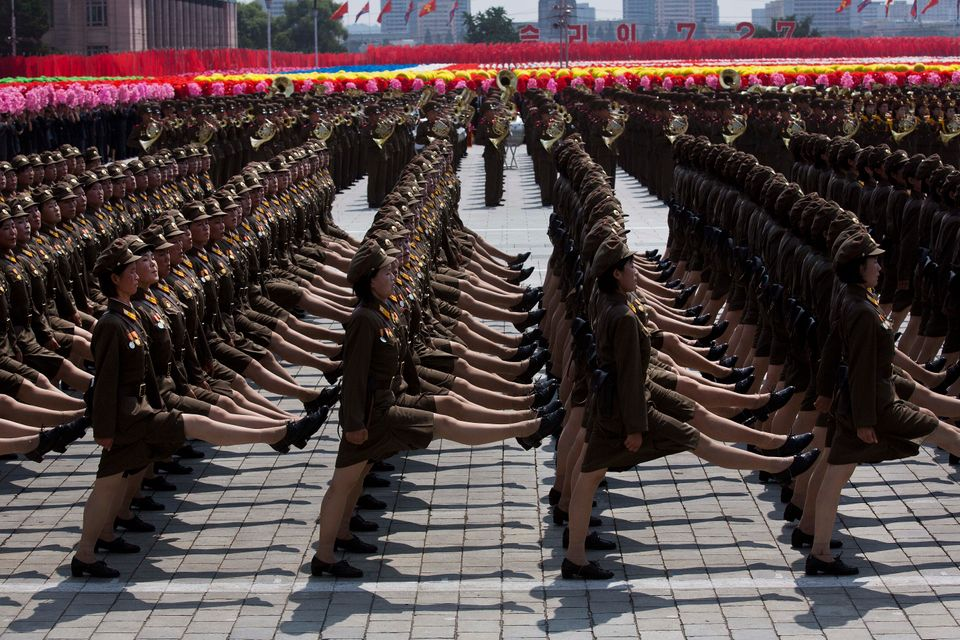 Female North Korean soldiers march during a mass military parade on Kim Il Sung Square in Pyongyang to mark the 60th annivers
