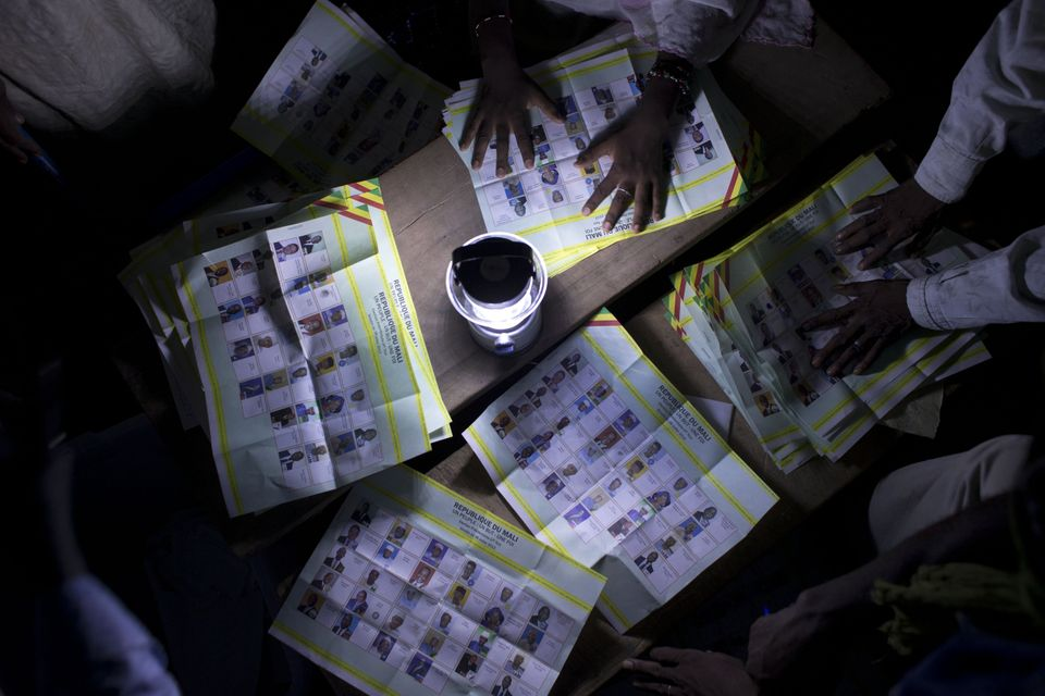 Election workers count votes at a station that reported a high voter turnout in Kidal, Mali Sunday, July 28, 2013. (AP Photo/