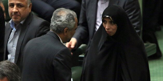 Iranian Vice President for legal matters Elham Aminzadeh (R) attends parliament session to discuss the President's proposed c