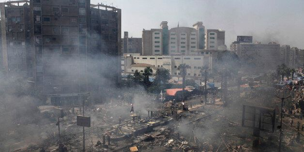 CAIRO, EGYPT - AUGUST 14:  Plumes of smoke rise from the site of a protest in support of deposed Egyptian President Mohammed