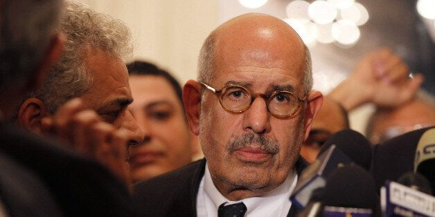 Egyptian opposition leader and Nobel Prize laureate Mohamed ElBaradei leaves at the end of a joint press conference on Novemb