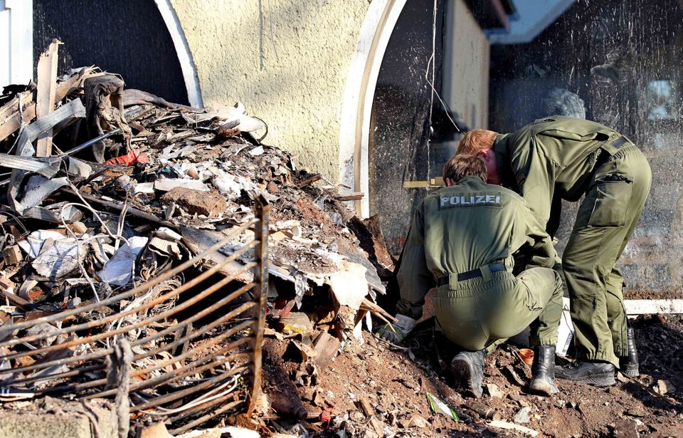 In this Nov. 9, 2011 file picture, police search in the debris of a house in Zwickau, Germany. Police claim that suspected te