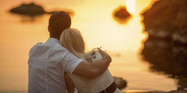 couple hugging on the beach at