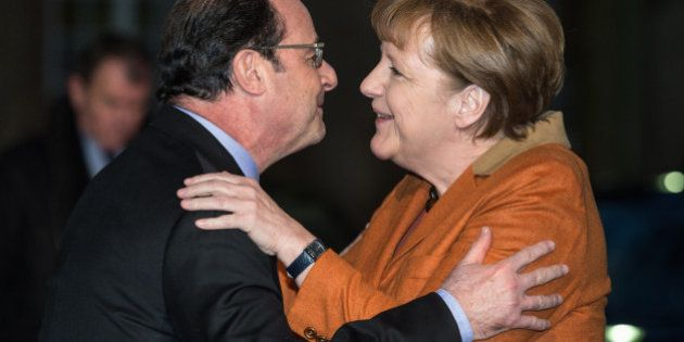 French president Francois Hollande, left, welcomes German Chancellor Angela Merkel upon her arrival in...