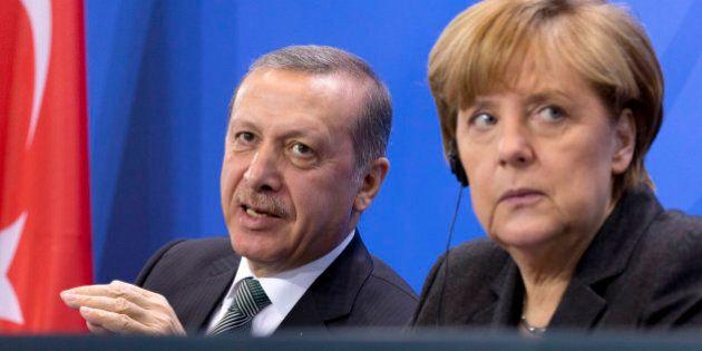 German Chancellor Angela Merkel, right, listens as Turkey's Prime Minister Recep Tayyip Erdogan, left,...