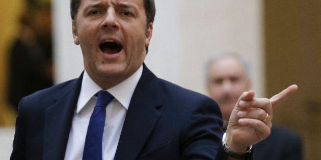 Italian Prime Minister Matteo Renzi, left, gestures as he waits for Afghan President Ashraf Ghani at...