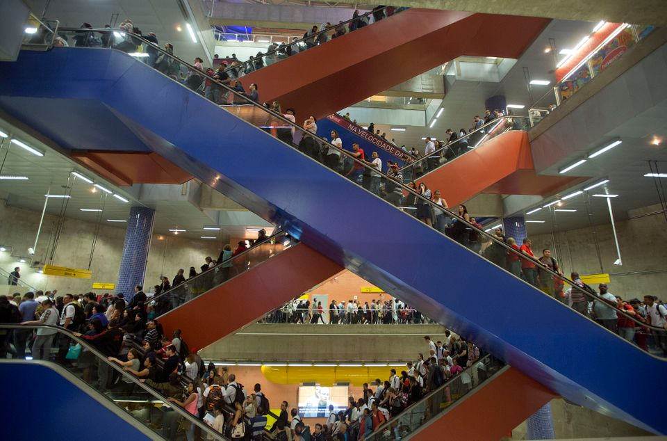 In this Aug. 7, 2013 photo, passengers ride escalators to access subway platforms in Sao Paulo, Brazil. (AP Photo/Andre Penne
