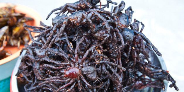 Deep fried Tarantula spiders, sold at hawker food stalls on Phnom Penh street. During the starvation years of Khmer Rouge rul