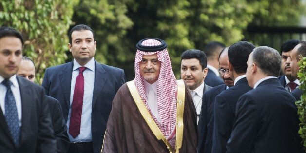 Saudi Foreign Minister Saud al-Faisal (C) arrives to attend an Arab League meeting on Syria on September 1, 2013 in Cairo, Eg