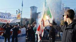 Feriti a Milano e Napoli. Bruciata bandiera Pd a