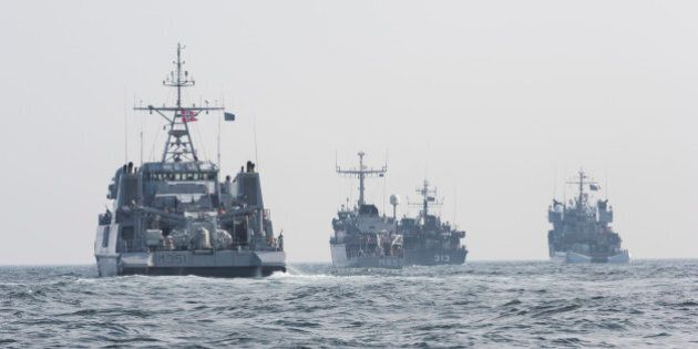 A convoy of warships is seen in the Baltic Sea along the German Coast, Germany, Tuesday, April 22, 2014....