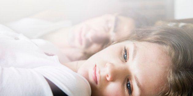 Couple lying on sofa,