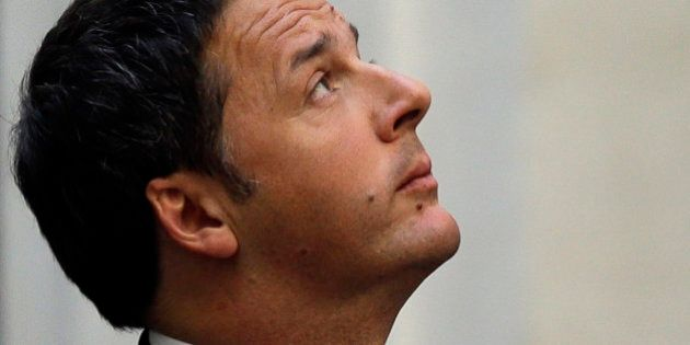 Italian Premier Matteo Renzi looks up as he waits for the arrival of Somali Prime Minister Omar Abdirashid...