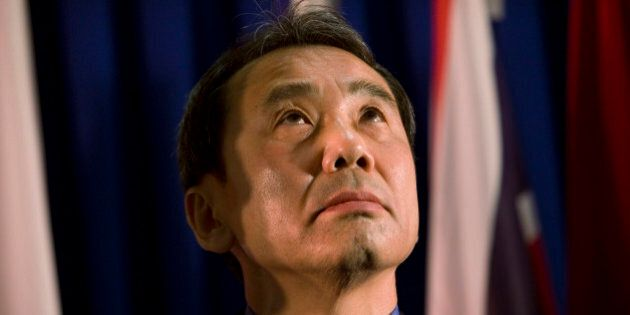 FILE - In this Feb. 15, 2009 file photo, novelist Haruki Murakami of Japan reacts before receiving the...