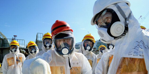 OKUMA, JAPAN - AUGUST 26:  Japan Trade Minister Toshimitsu Motegi in protective suit checks the situation of halting contamin