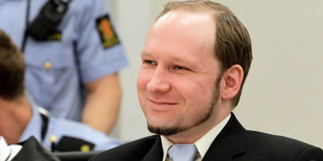 Mass killer Anders Behring Breivik smiles during his trial in room 250 of Oslo's central court on June 21, 2012.  The trial o