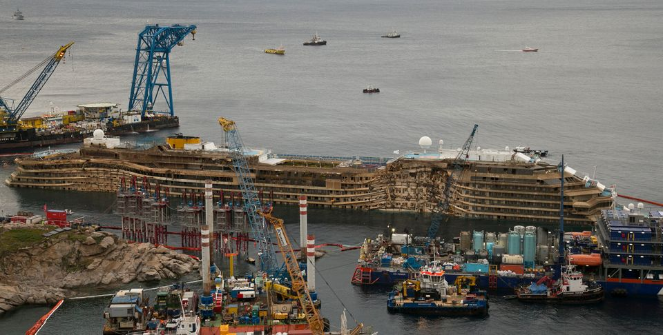 The Costa Concordia is seen after it was lifted upright on the Tuscan Island of Giglio, Italy, early Tuesday morning, Sept. 1