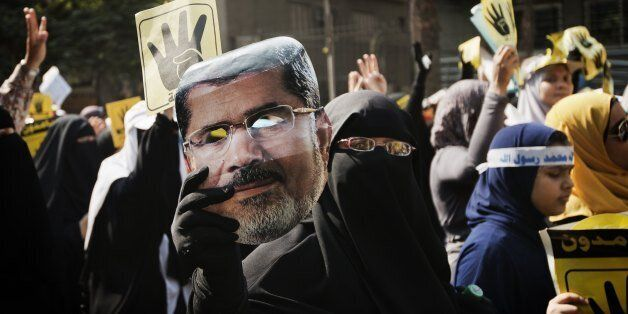 Members of the Muslim Brotherhood and suporters of ousted President Mohamed Morsi march through Cairo's Maadi Neighborhood on