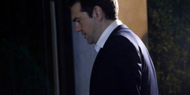 Greece's Prime Minister Alexis Tsipras leaves the Presidential Palace after his meeting with the Greek...