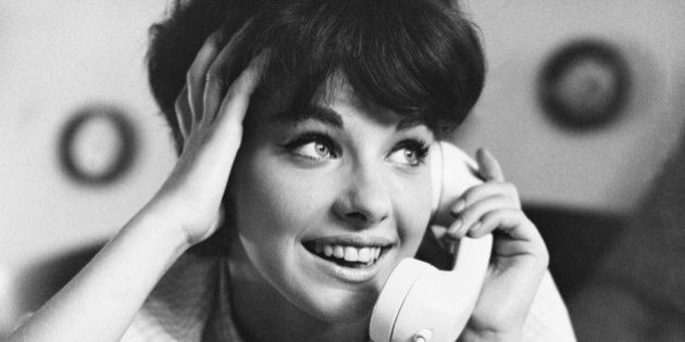 Sixteen-year-old girl, Michelle Tuttle, talking on the phone. Photographed in