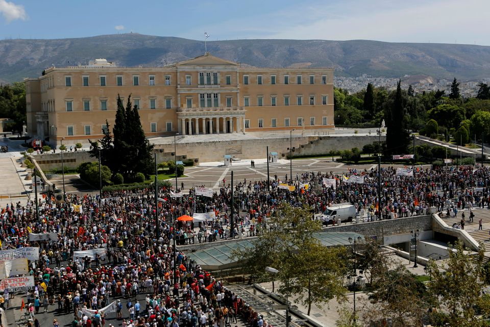 Thousands of civil servants march outside the Greek parliament, in central Athens on Wednesday, Sept. 18, 2013, during a two-