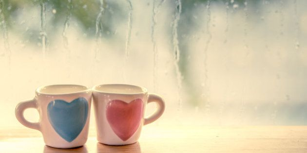 two lovely glass on rainy day window background in vintage color