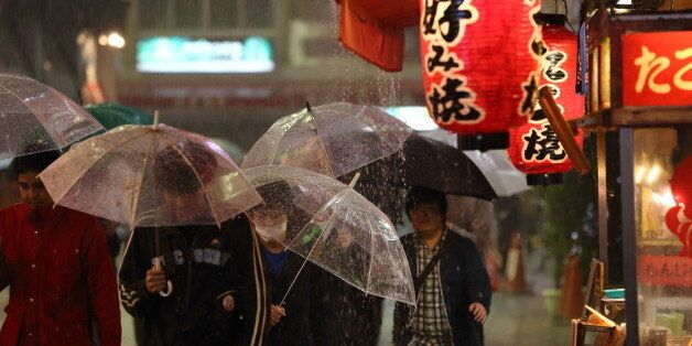 People walk through Namba area in a rainy day.