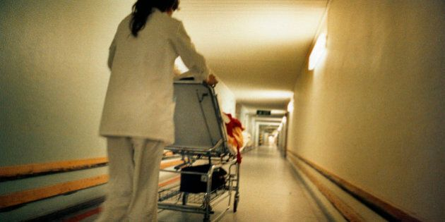 A nurse transporting a patient in a hospital,