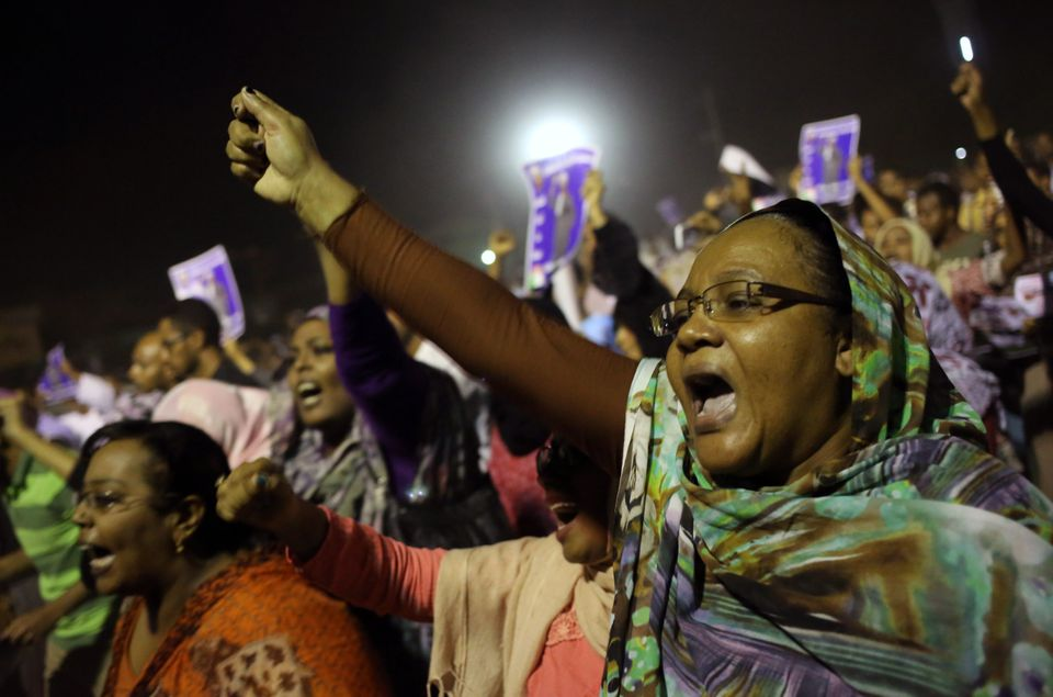 Sudanese anti-government protesters chant slogans during a demonstration in Khartoum, Sudan, Sunday, Sept. 29, 2013.  (AP Pho
