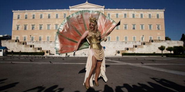 A Drag Queen performer poses for photos during a Gay Pride event march past the Tomb of the Unknown Soldier...