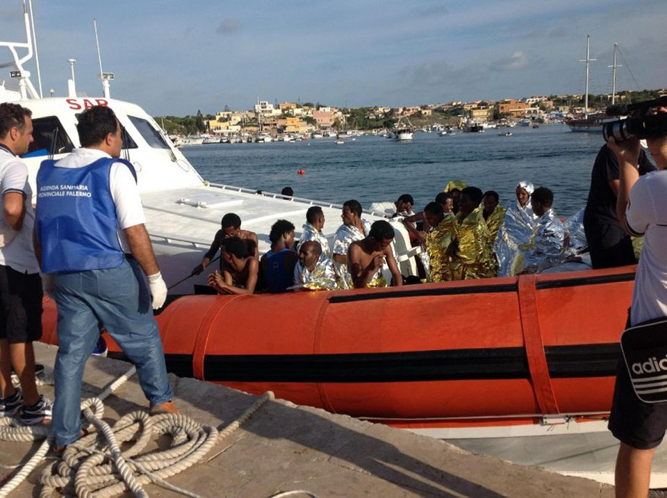 An Italian Coast Guard boat carry rescued migrants as they arrive in the port of Lampedusa Thursday, Oct. 3, 2013. (AP Photo/