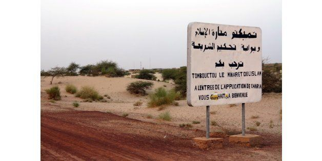 This picture on July 26, 2013 shows an old sign reading 'Timbuktu the minaret of islam, at the entrance of the sharia rule, w