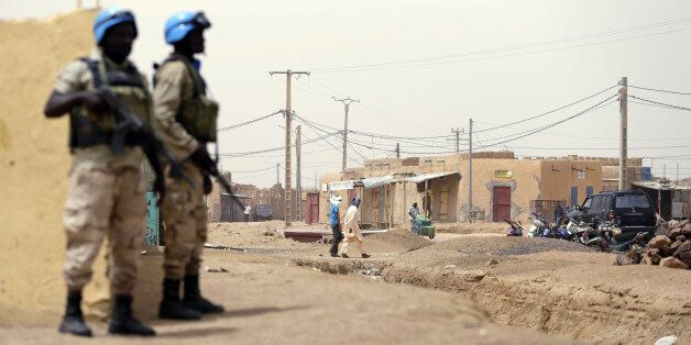 United Nations (UN) soldiers patrol on July 27, 2013 in the northern Malian city of Kidal. Clashes between Tuaregs and black