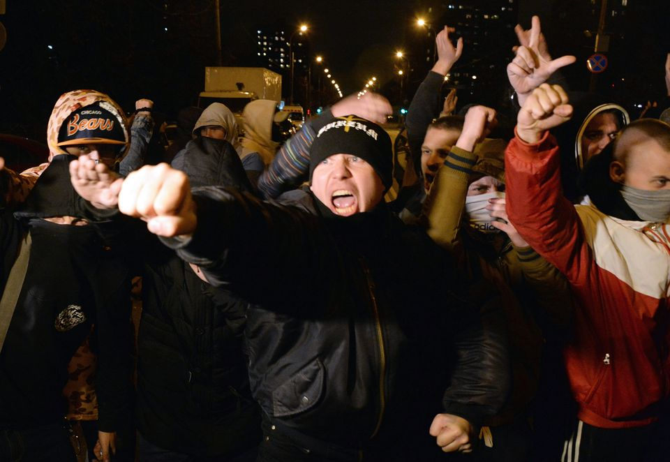 Russian ultra-nationalists shout slogans during a protest in the Biryulyovo district of Moscow, late on October 13, 2013. Mos