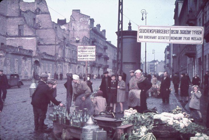 """Warsaw, Nazi-occupied Poland, 1940. The signs read, """"Typhus area. Passage permitted only while traveling."""""""