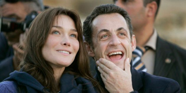 ** FILE ** French President Nicolas Sarkozy, right, and his new girlfriend - supermodel-turned singer...