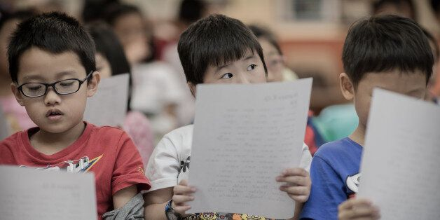 TO GO WITH Lifestyle-education-Hong-Kong-language,FEATURE-SPECIAL by Peter Hutchison This picture taken on September 29, 201