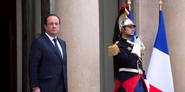 French president Francois Hollande stands after a meeting with Austrian republic president Heinz Fisher, at the Elysee Palace