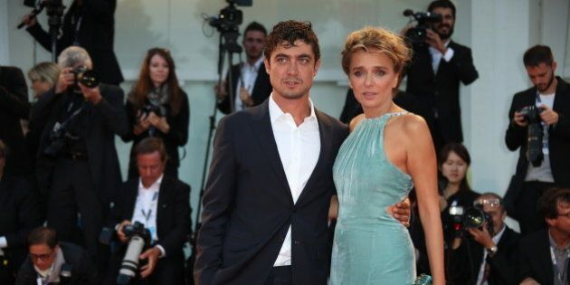 Actors Riccardo Scamarcio, left, and Valeria Golino pose for photographers upon arrival for the film,...