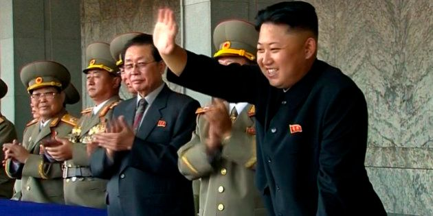 FILE - In this Sept. 9, 2013 file image taken from video, North Korean leader Kim Jong Un, right, waves...