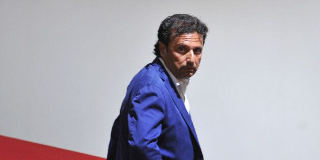 The captain of the ill-fated Costa Concordia cruise ship, Francesco Schettino takes place for his trial on July 9, 2013 in Gr