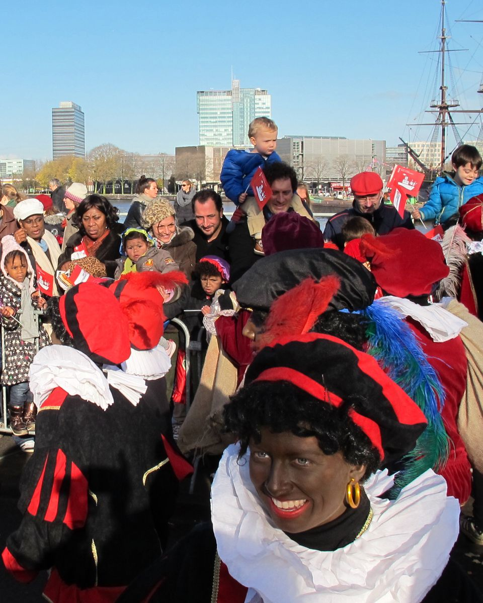 "In this Nov. 18, 2012 photo persons dressed as ""Zwarte Piet"" or ""Black Pete"" attend a parade after St. Nicholas, or Sinterkla"