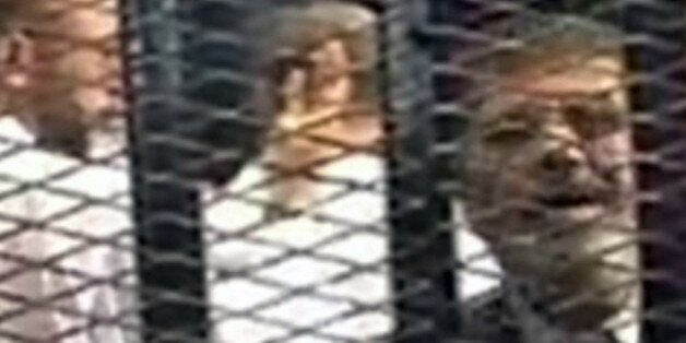CAIRO, EGYPT  NOVEMBER 4 :  Mohammed Morsi is seen in court on November 4, 2013 for his trial at Cairo Police Academy in Egyp