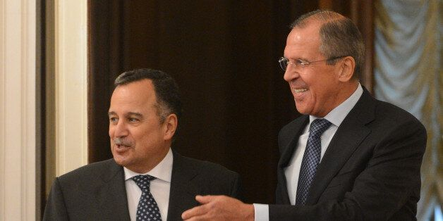 Russian Foreign Minister Sergei Lavrov (R) speaks with his Egyptian counterpart Nabil Fahmy as they meet in Moscow, on Septem