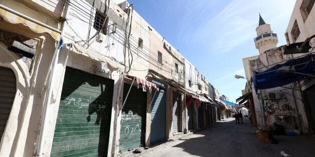 A picture taken on November 17, 2013, shows closed shops in the Libyan capital Tripoli. Local authorities in Tripoli announce