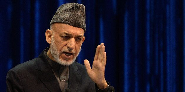Afghan President Hamid Karzai addresses the Afghan loya jirga, a meeting of around 2,500 Afghan tribal elders and leaders, on