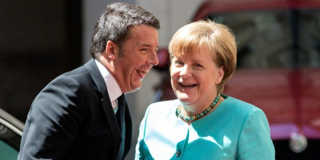 Matteo Renzi, Italy's prime minister, left, greets Angela Merkel, Germany's chancellor, ahead of their...