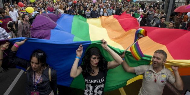 Participants hold a rainbow flag during the annual gay pride parade march in Belgrade, Serbia, September...